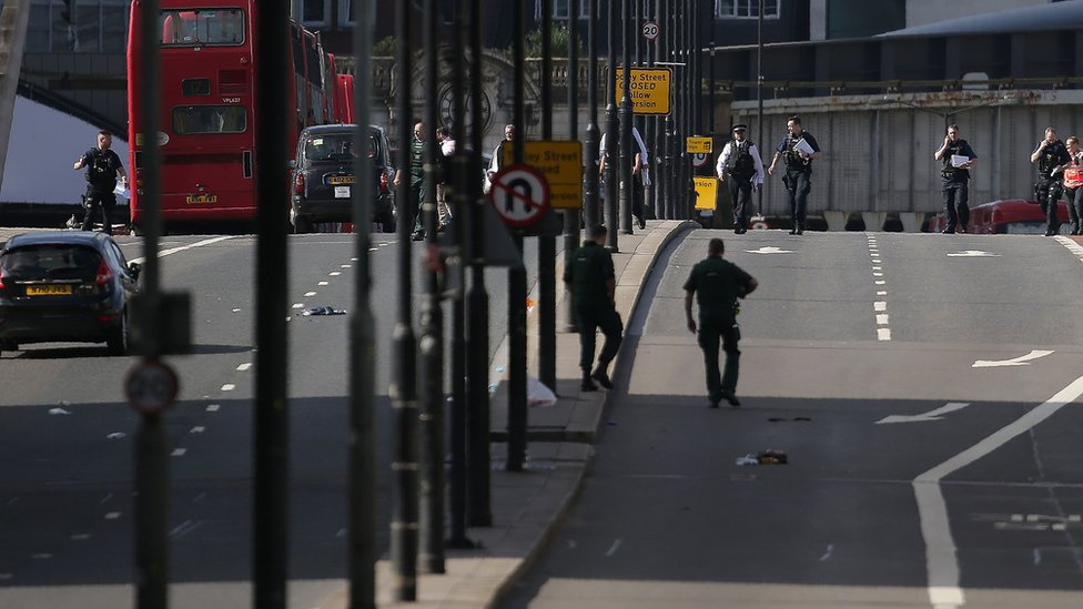 Members of the Police and Ambulance service assess the scene on London Bridge