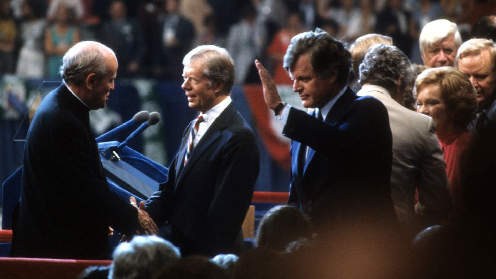 President Jimmy Carter is congratulated by Senator Robert Drinan and Presidential candidate Senator Ted Kennedy after giving a speech at the Democratic National Convention in 1980