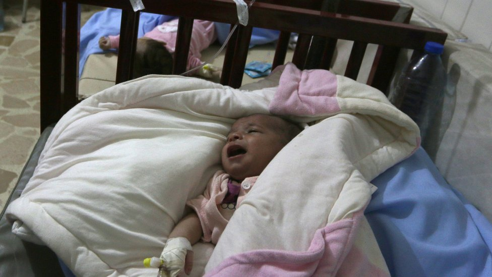Babies lie on beds after being transferred to an underground unit at a children's hospital damaged in air strikes in rebel-held Aleppo (24 July 2016)