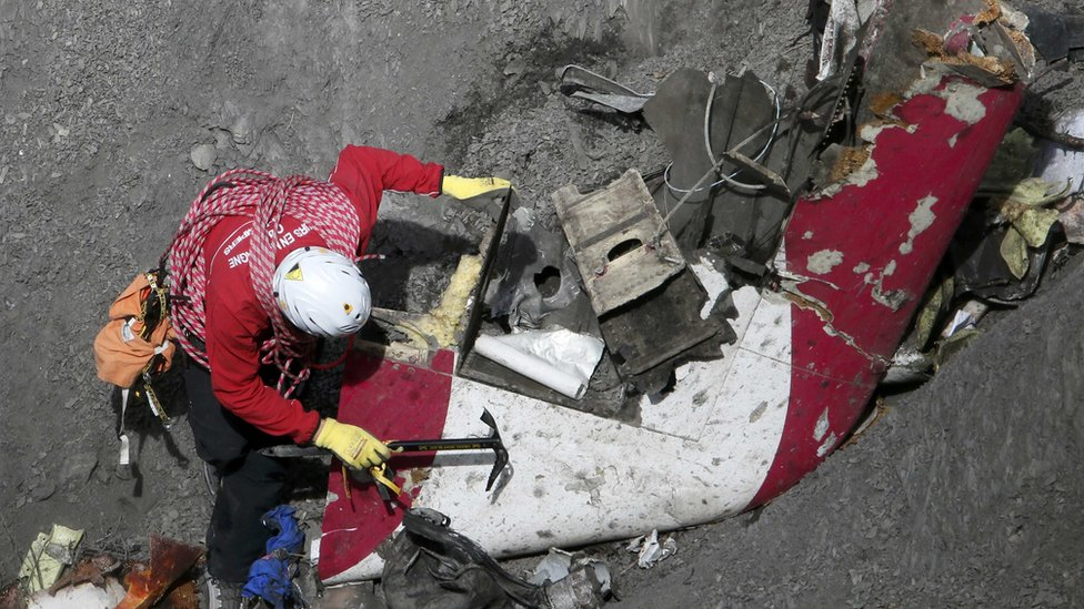 French rescue workers inspects debris from Flight 9525 - March 2015