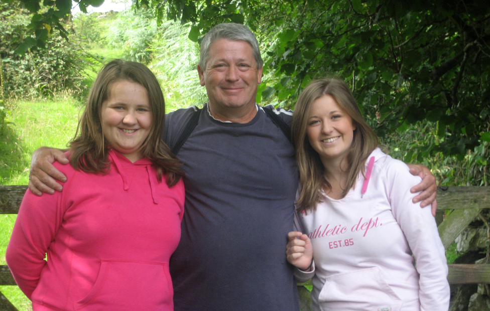 Nigel Hurst with his two daughters