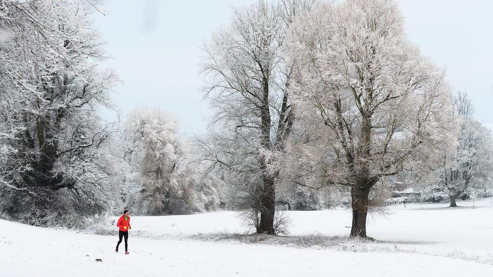 A man jogging through a park in High Wycombe