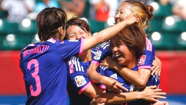 Japan's Mana Iwabuchi celebrates with her teammates after scoring the winning goal