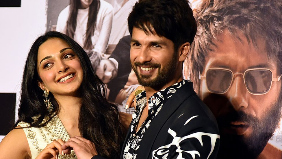 Kiara Advani (L) and Shahid Kapoor (R) pose for photographs during the trailer launch of the upcoming Hindi film 'Kabir Singh' in Mumbai on May 13, 2019.