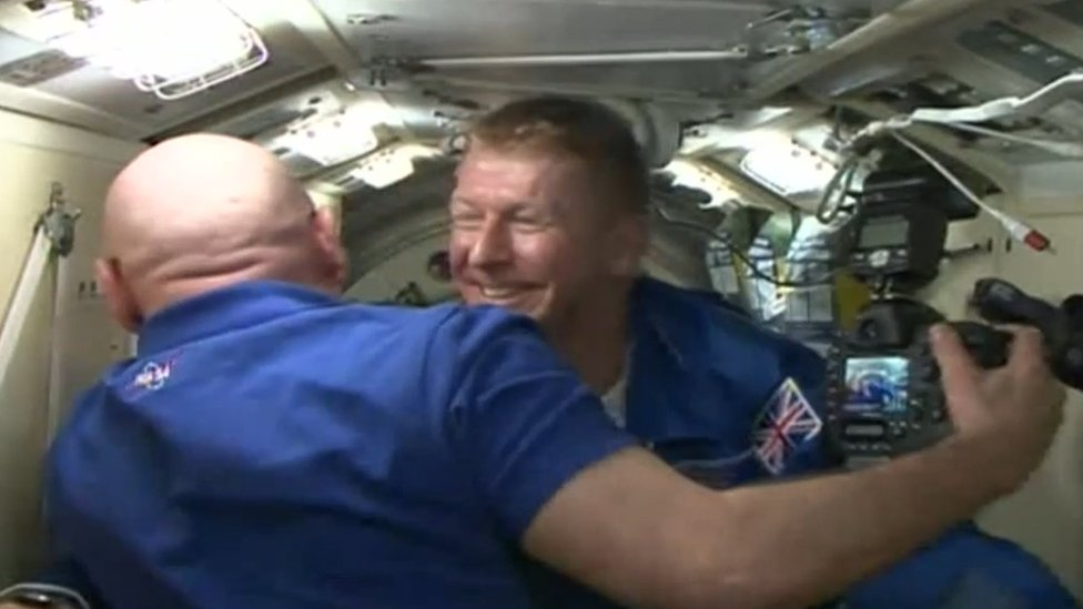 Screen grab from footage issued by European Space Agency of British astronaut Tim Peake emerging from the Soyuz space capsule hatch at the International Space Station.