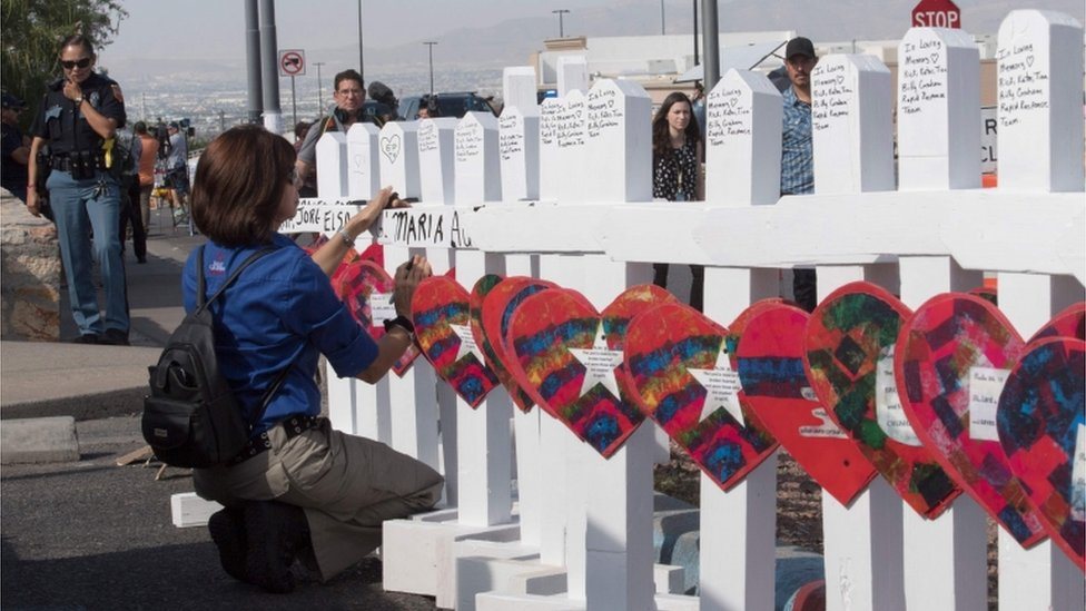 """Members of the """"Crosses for Losses"""" group arrive at the scene with crosses for each victim, after the shooting that left 21 people dead at a WalMart in El Paso, Texas"""