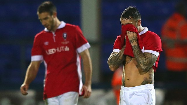 Salford City players look dejected after conceding against Hartlepool