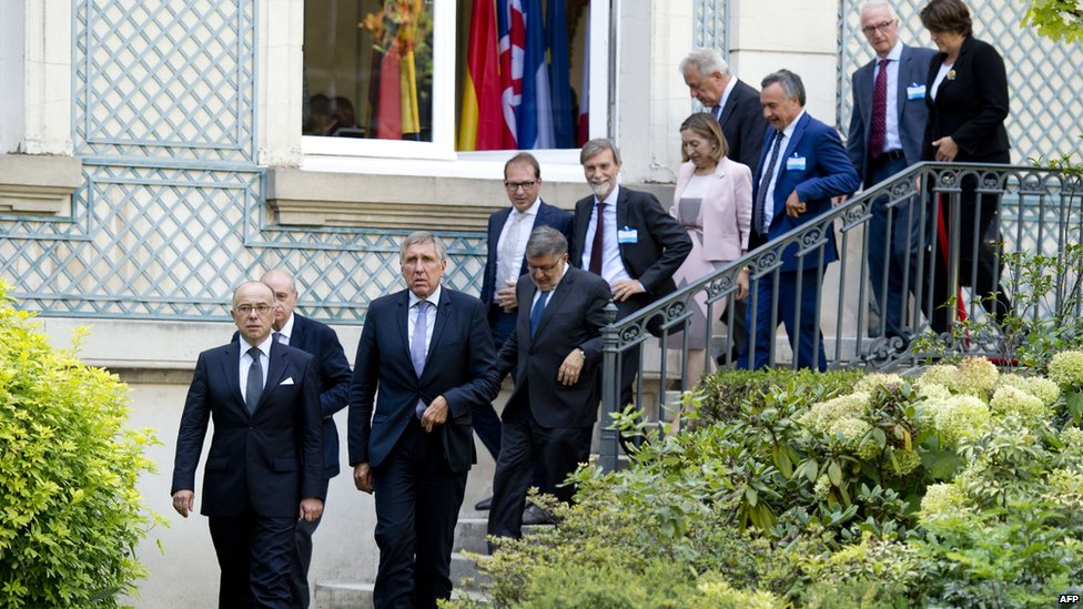 French Interior Minister Bernard Cazeneuve (left) walks with some of the European interior and transport ministers in Paris on 29 August 2015
