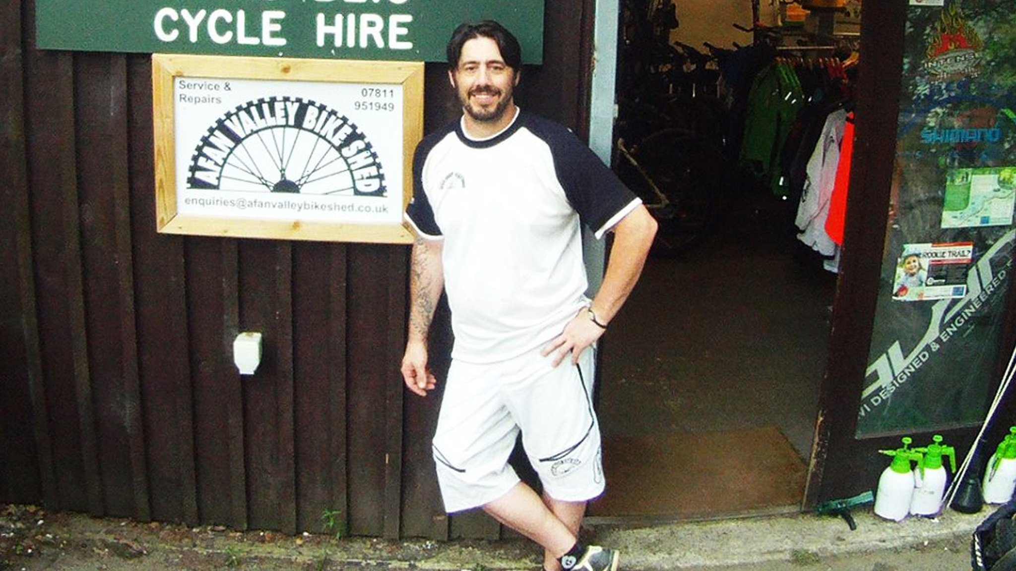 Ben Threlfall outside his bike shop