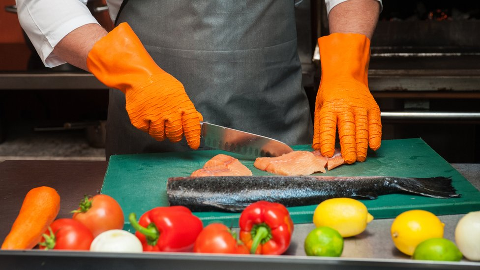 Salmon being prepared