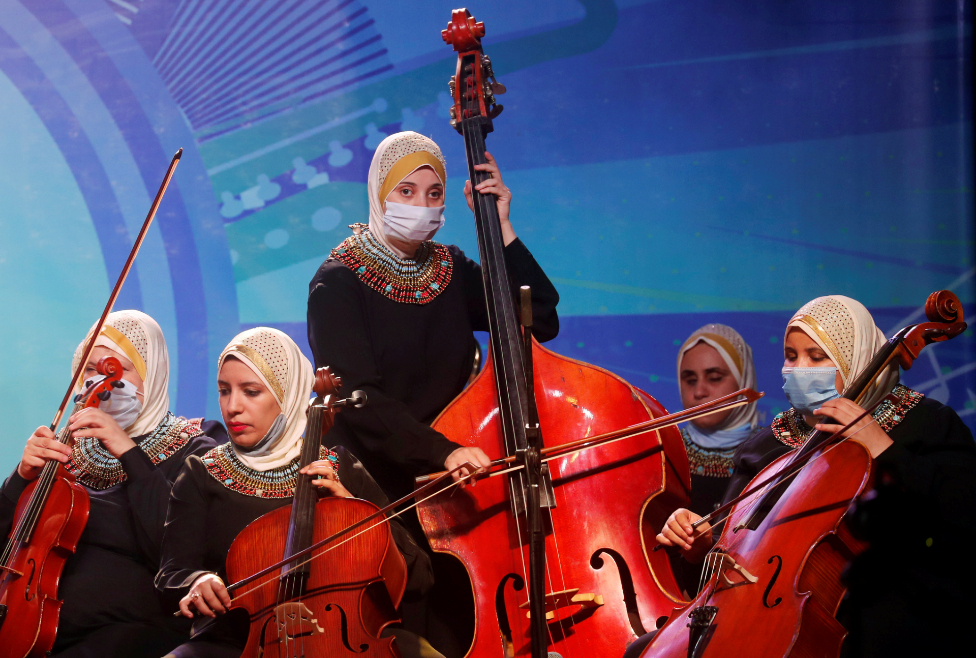 Members of Al-Nour Wal Amal (Light and Hope) chamber orchestra of blind women wearing protective masks play during their first concert, in Cairo, Egypt, September 20, 2020.