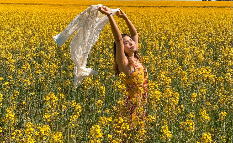 Ridzkhi Andhini poses for a picture among the canola