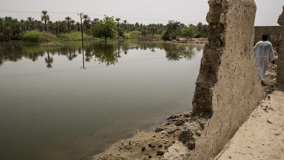 A damaged building seen near a submerged area after flash floods hit Merove town of Khartoum, Sudan on 13 September 2020