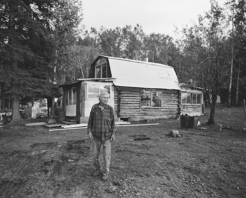 A resident in front of one of the cabins