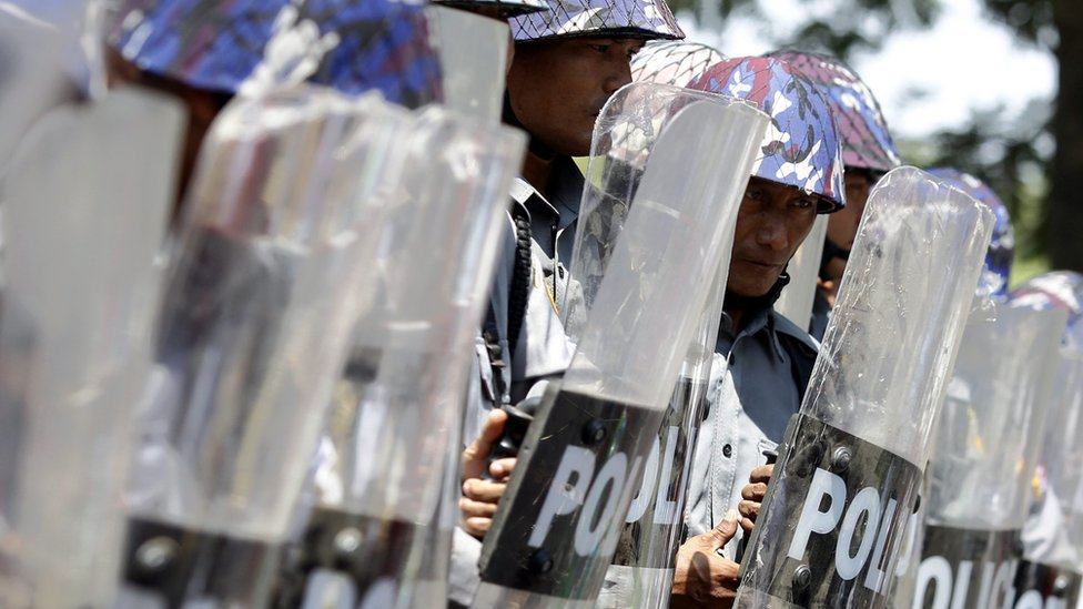 "Riot police officer stand in line as they block the road to stop a protesters"" march demanding labor rights in TetKone, near Naypyidaw, Myanmar, 18 May 2016."