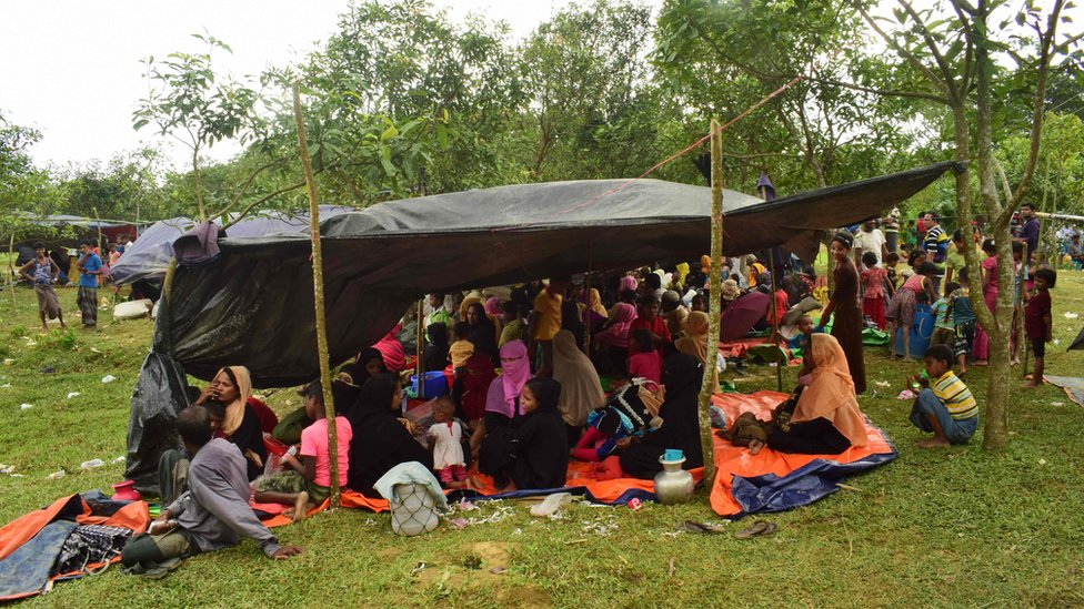 Fleeing Rohingya refugees rests under a makeshift shelter, in Bangladesh on August 27, 2017
