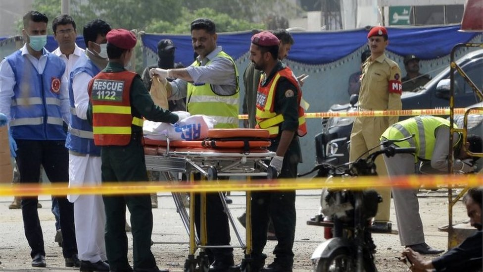 Pakistani security officials collect evidence from the scene of a suicide bomb attack on a census team in Lahore on April 5, 2017.