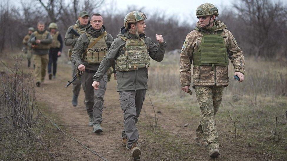 President Zelensky (front L) with Ukrainian troops, 9 Apr 21