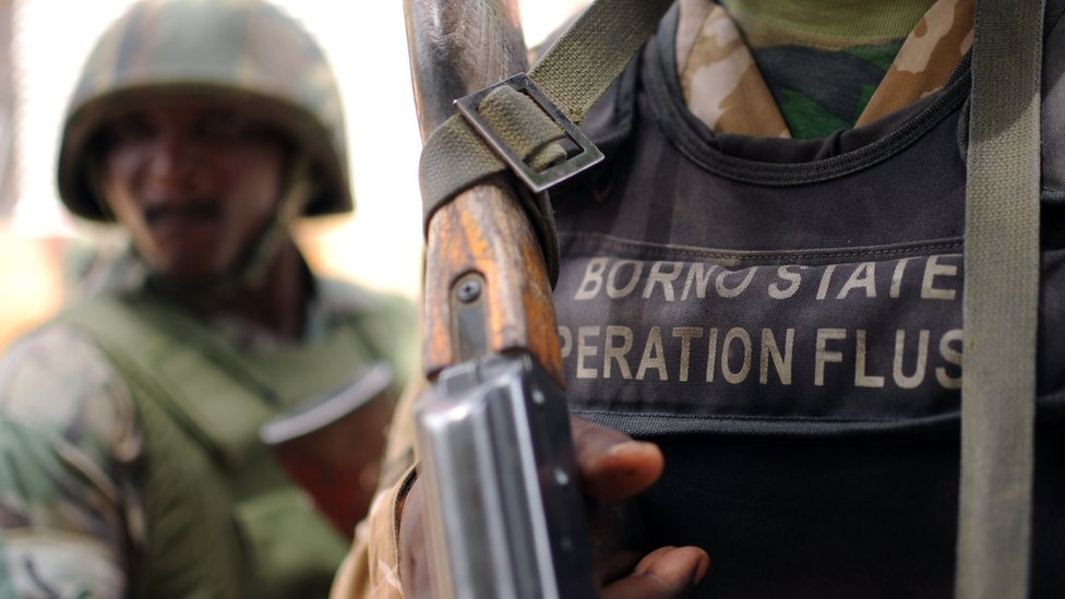 """Nigerian soldiers of the """"Operation Flush"""" stand in a military camp in Maiduguri capital of Borno state on June 6, 2013"""