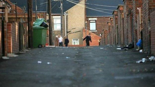 Children playing on a run-down street