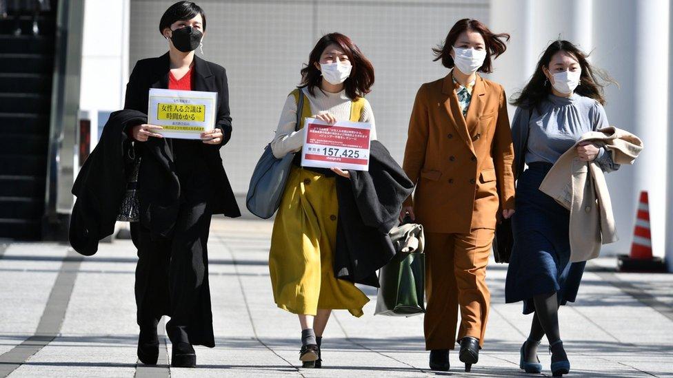 Momoko Nojo walking with other female signatories