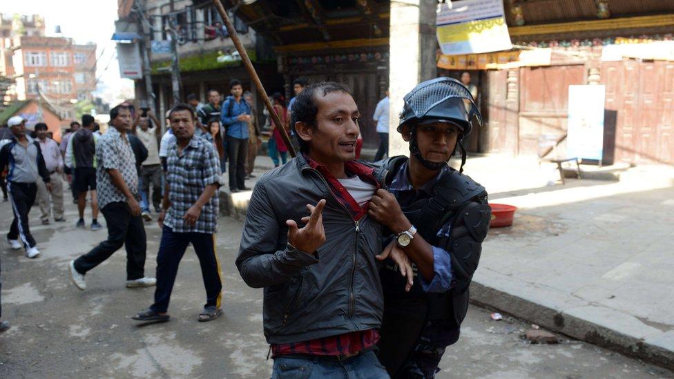 Nepalese arrest a protester in Kathmandu on 20 September 2015