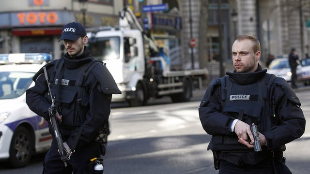 Armed French police patrol the north of Paris.