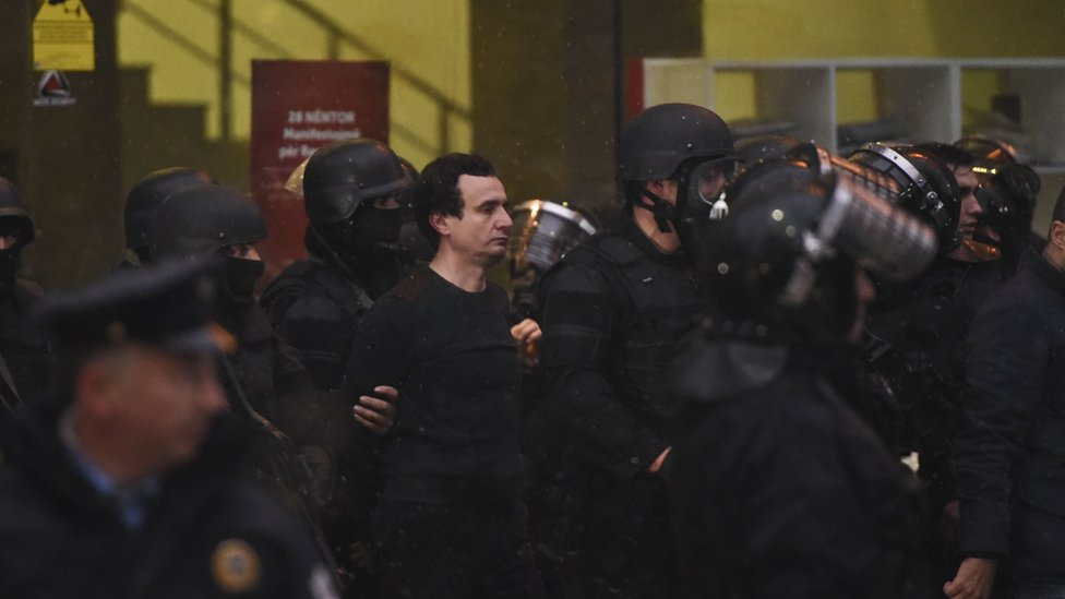 Kosovar policemen detain opposition lawmaker Albin Kurti (C) at the Vetevendosje headquarters
