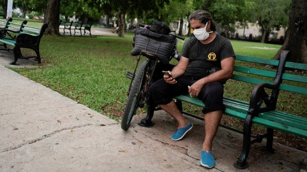A man connects to the internet at a hotspot in a public park in Havana, Cuba, July 14, 2021.