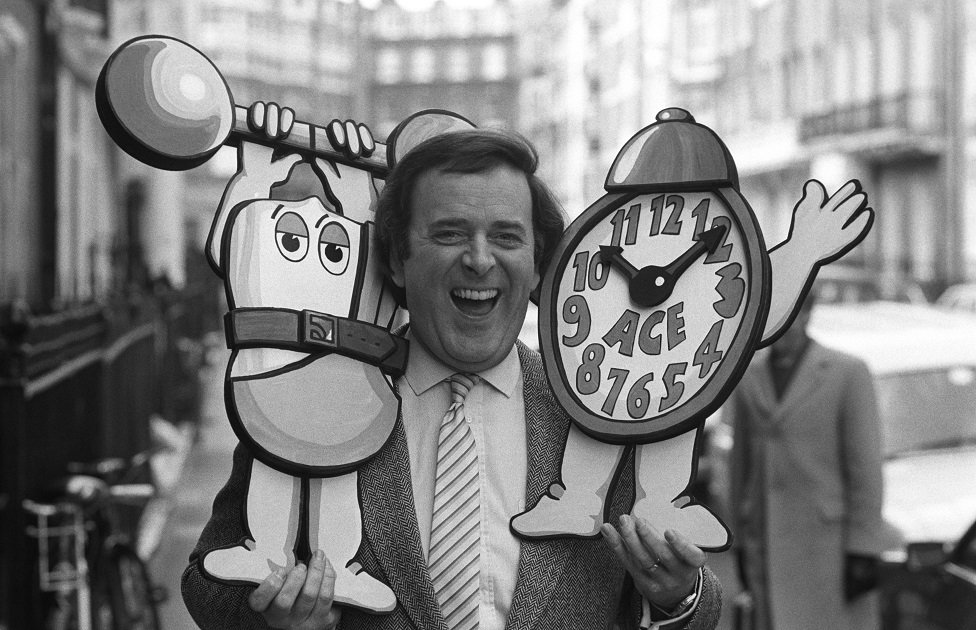 Terry Wogan poses with an alarm clock on in April 1984.