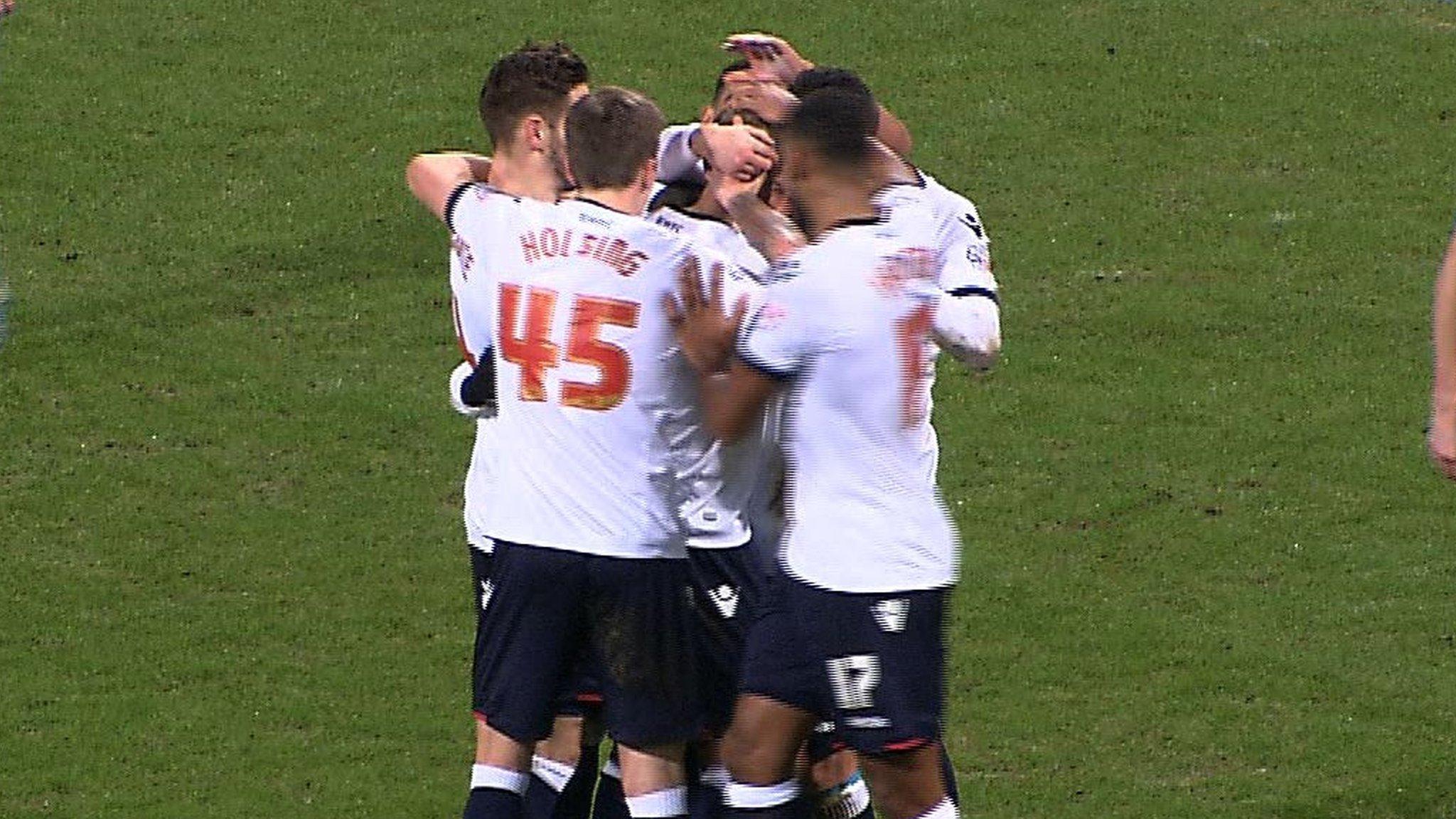 Bolton celebrate Moxey's goal