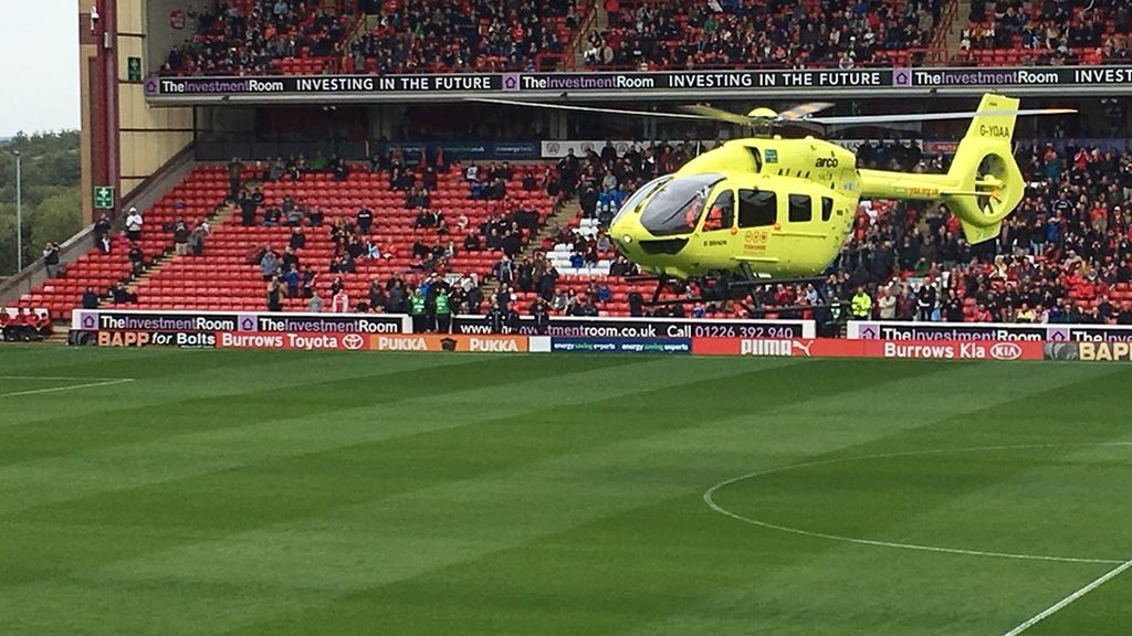 Air ambulance lands on pitch as illness postpones Barnsley-Burton