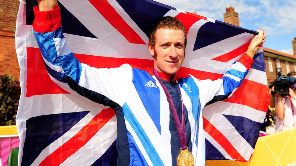 Great Britain's Bradley Wiggins celebrates winning the Men's Individual Time Tri