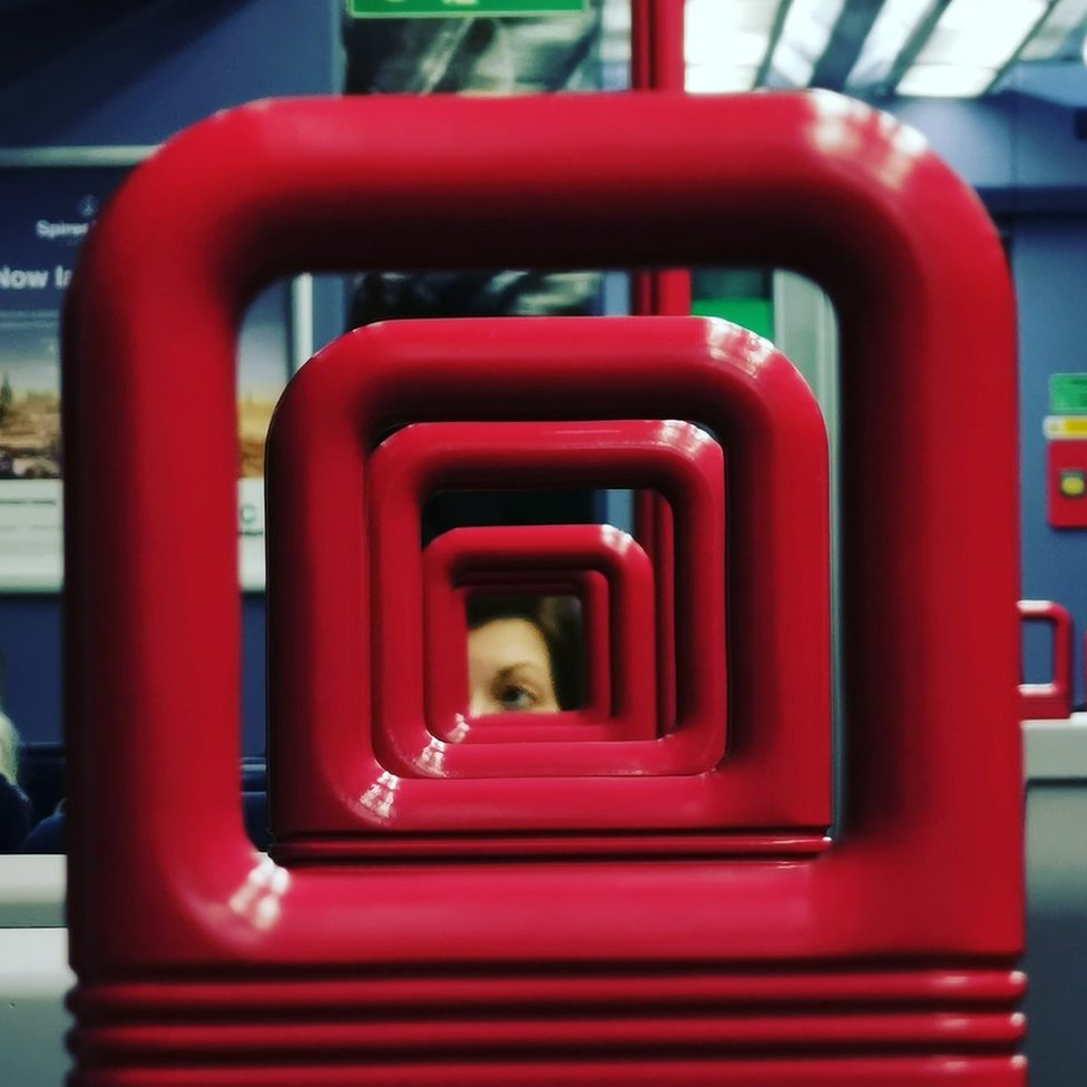 Red train chair handles in a row