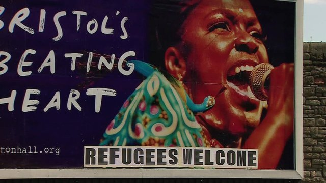 Refugees Welcome printed on billboard advert