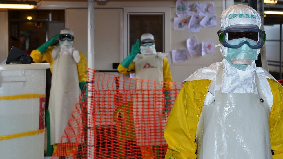 Health workers wearing protective gear at the Nongo Ebola treatment centre in Conakry, Guinea, on August 21, 2015