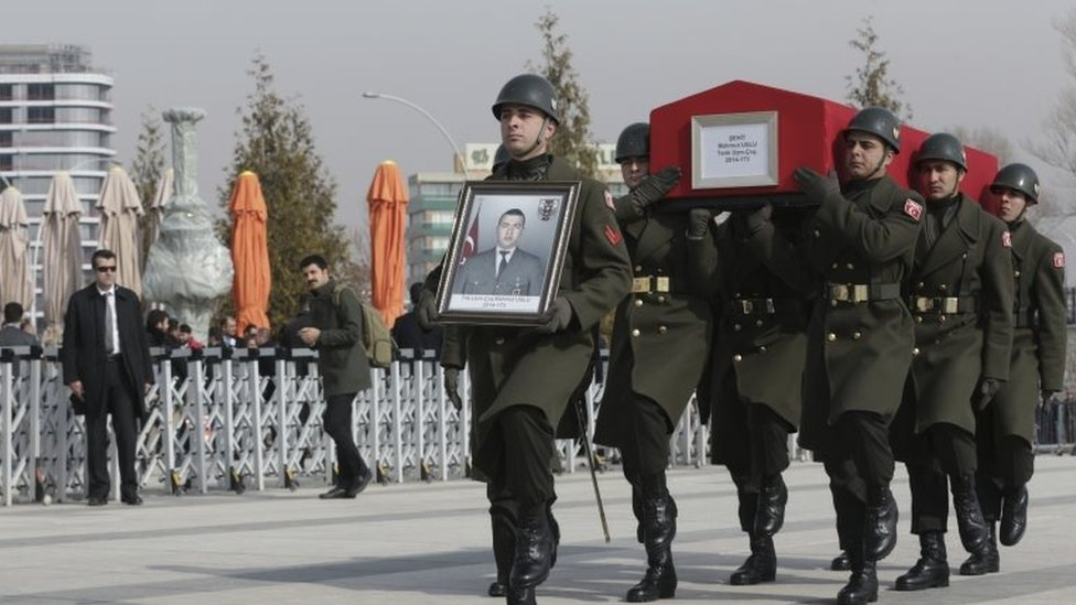 Military honour guard carry the coffin of Mahmut Uslu, one of five Turkish soldiers killed in an attack by IS militants around the Syrian town al Bab on Tuesday, during a ceremony in Ankara, Turkey, on 9 February