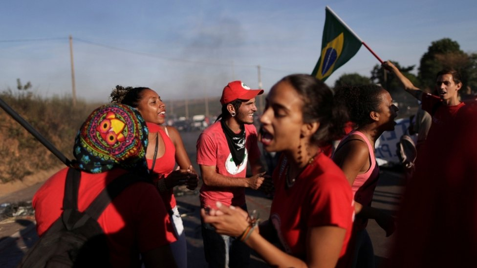 Members of the Landless Workers Movement (MST) take part in a protest against the impeachment
