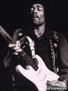 Jimi Hendrix performs onstage, late 1960s