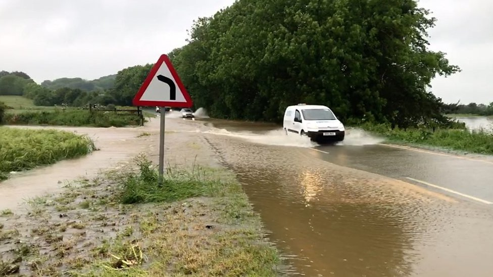England flooding: Travel disrupted across the country