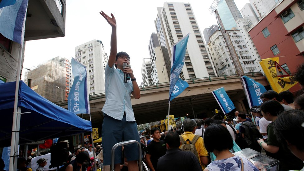 Pro-democracy activist Joshua Wong wave to supporters during a protest march in Hong Kong, China July 1, 2018, the day marking the 21st anniversary of the city's handover to Chinese sovereignty from British rule.