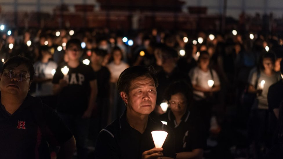 Participants take part at the candlelight vigil as they hold candles at Victoria Park on June 4, 2018 in Hong Kong
