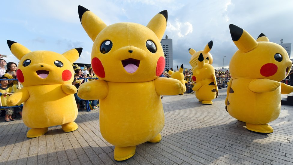 Dozens of people dressed up as Pikachu, the famous character of Nintendo's videogame software Pokemon