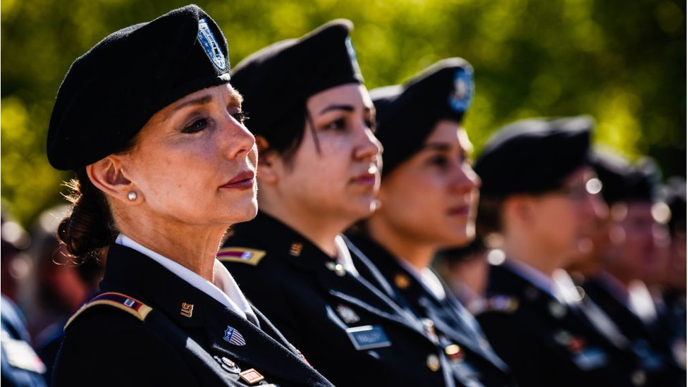 Chief Warrant Officer Four, Rosemary Masters, of Oklahoma Army National Guard, left, listens to the speaker during the 20th Anniversary of Women In Military Service For America Memorial celebration on Saturday, October 21, 2017, at the Arlington National Cemetery in Arlington, VA.