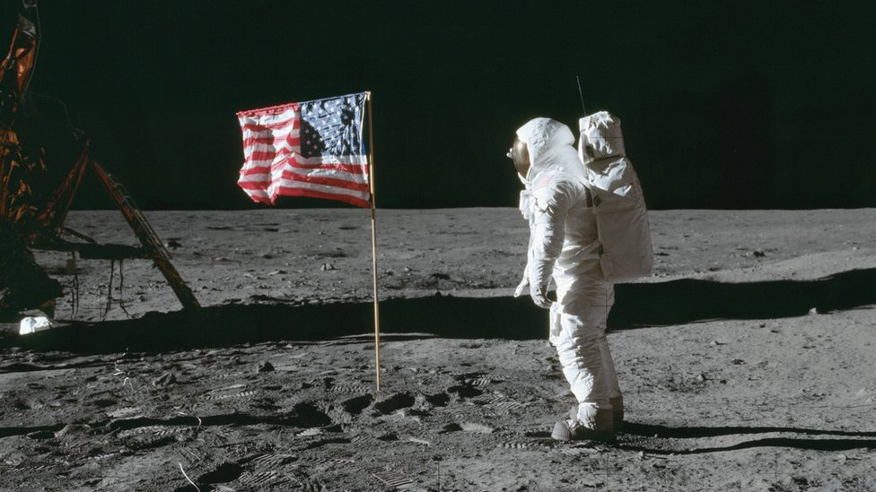 buzz aldrin by the flag in 1969