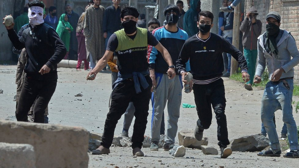Kashmiri protestors clash with Indian security forces near a polling station in Srinagar on April 9, 2017.
