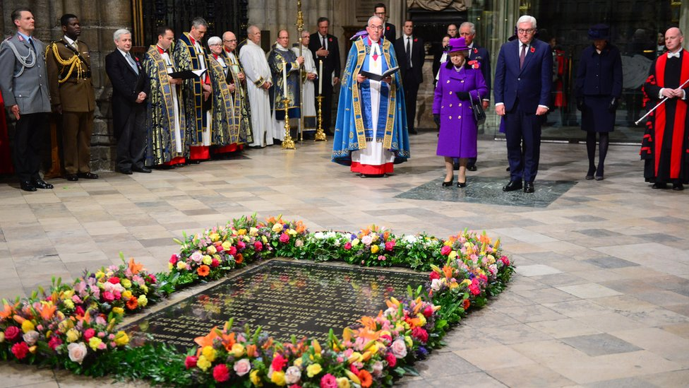 The Queen and senior royals attended Westminster Abbey on Sunday evening where flowers were laid on the grave of the Unknown Warrior