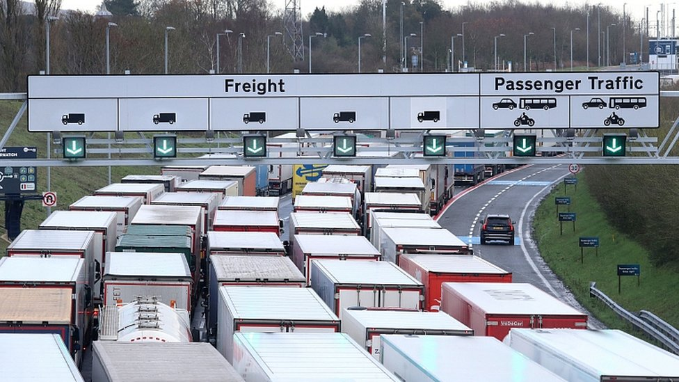 Lorries queue to access the Eurotunnel site near Folkestone in Kent