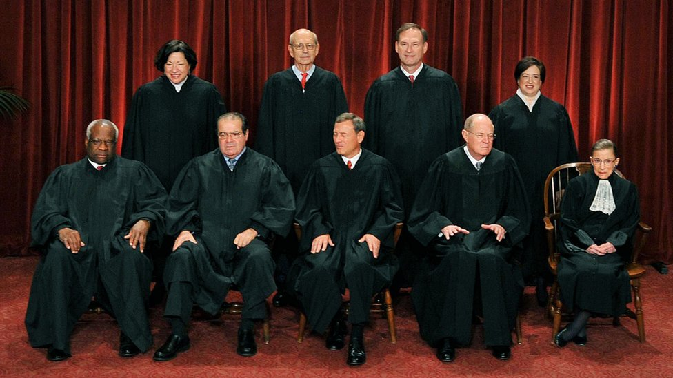 Front row (L-R): Associate Justice Clarence Thomas, Associate Justice Antonin Scalia, Chief Justice John G. Roberts, Associate Justice Anthony M. Kennedy and Associate Justice Ruth Bader Ginsburg. Back Row (L-R): Associate Justice Sonia Sotomayor, Associate Justice Stephen Breyer, Associate Justice Samuel Alito Jr. and Associate Justice Elena Kagan.