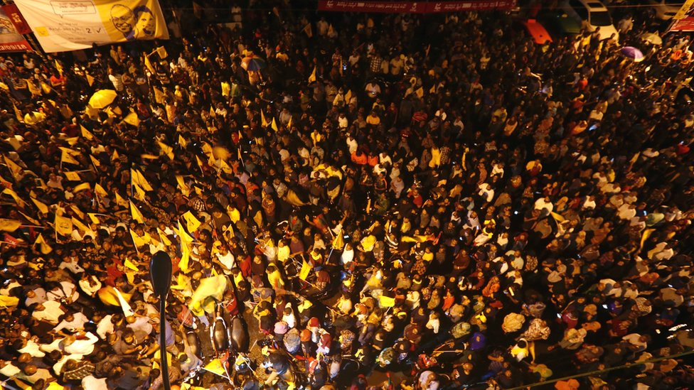 Supporters of Maldivian joint-opposition presidential candidate Mohamed Solih celebrate in Male